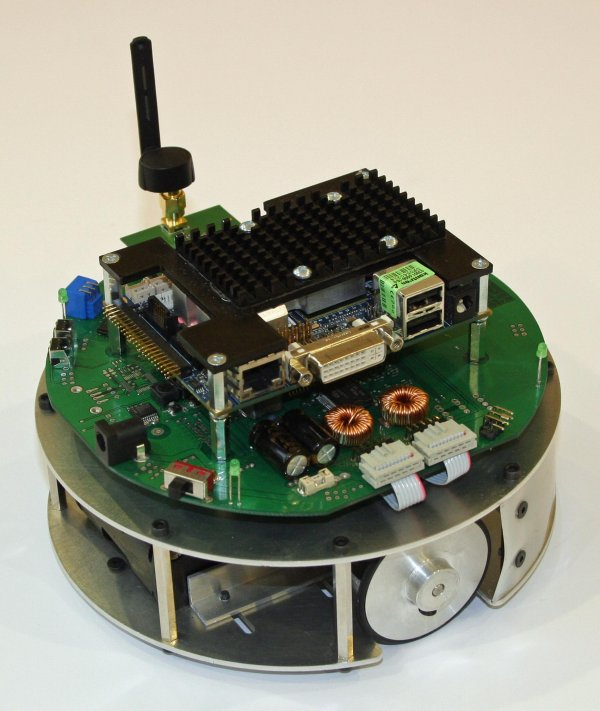 Cooperating mobile robots in structured environment.