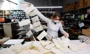 Surgical masks being made at a leather workshop in Italy. Photograph: Miguel Medina/AFP via Getty Images